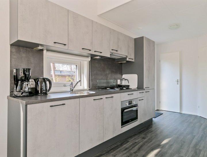 Duntep Mungo plat dak model verhuurchalet keuken moderne chalet