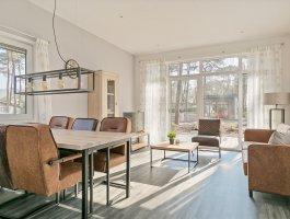Duntep Mungo plat dak model verhuurchalet woonkamer moderne chalet