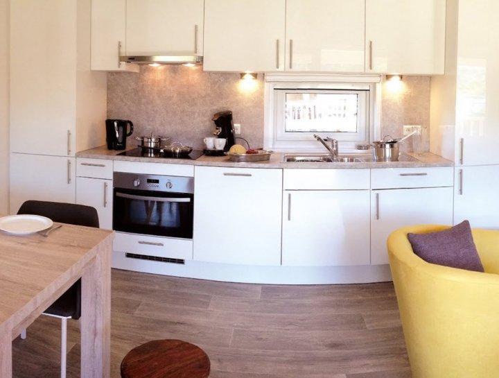 Bolton recreatiechalet - interieur - keuken - Duntep - mobiele bungalowsde verrhuur. Standaard met terras. Van Duntep chaletbouwer